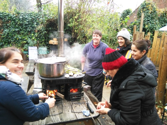 Four people cooking on the Ecozoom La Plancha stove